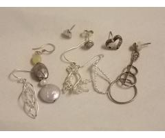 Lot #14 earring lot either marked silver or appears silver missing mates