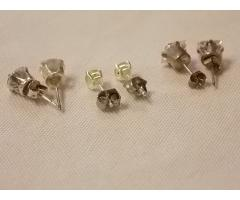 Lot #19 earrings either marked silver or appear to be silver