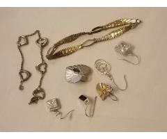 Lot #21 jewelry lot either marked silver or appears to be silver earrings missing mates
