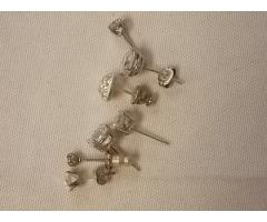 Lot #27 earring lot missing mates either marked silver or appears to be silver